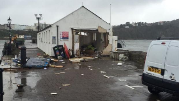 The harbourmaster's office on Tenby harbour has been damaged due to high waves