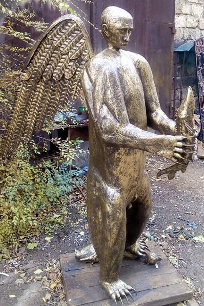 16133528_02_putin_bear_sculpture_from_as